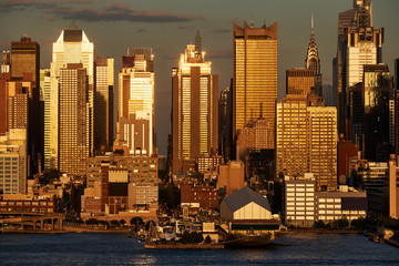 Aerial sunset view of Midtown West skyscrapers from across the Hudson River. Manhattan, New York City, USA