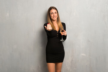 Woman with champagne celebrating new year 2019 presenting and inviting to come