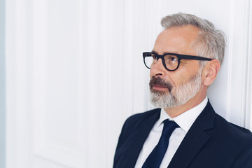 Bearded man in glasses and suit side portrait