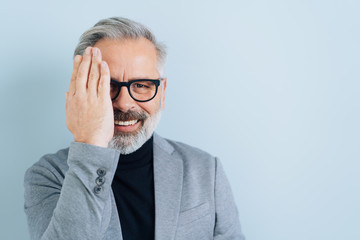 Portrait of happy middle-aged man with eyeglasses