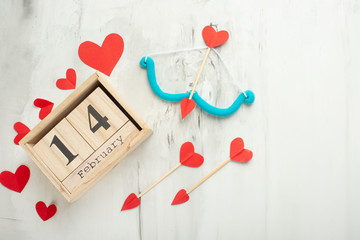 Valentine's Day theme with wooden block calendar, with bow and arrow cupid