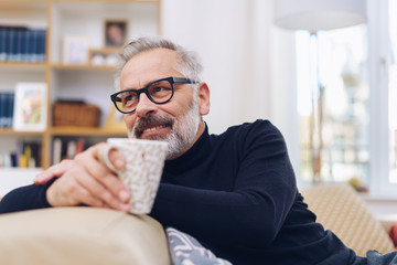 Middle-aged man relaxing in his living room