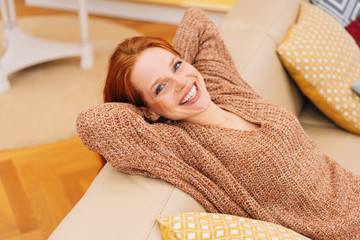 Happy young woman with a beaming vivacious smile