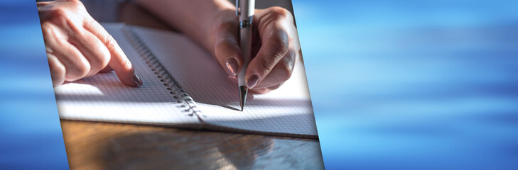 Woman writing on notebook. panoramic banner