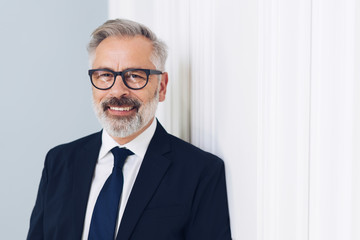 Happy middle-aged businessman wearing glasses