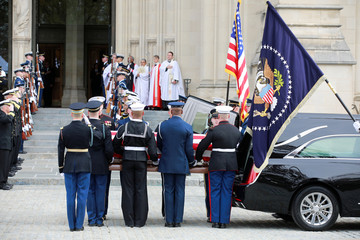 A military honor guard carries the casket of former U.S. President George H.W. Bush at Washington National Cathedral