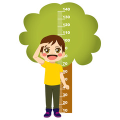 Young little child standing on front of funny tree height measure