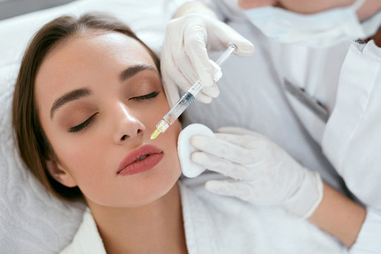 Lip Augmentation. Woman Getting Beauty Injection For Lips