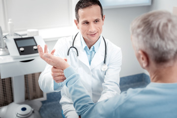 Positive delighted medical worker checking pulse