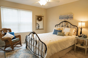 Neutral Bedroom with Iron Bed