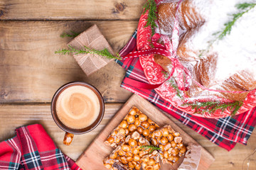 Italian Christmas pastries with lemon and powdered sugar. Typical sweet and aromatic coffee for the holiday in winter. Photo in a rustic style. Free space for text.