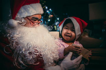 Happy santa clause with little girl on decorate christmas background,Thailand people,Merry x'mas
