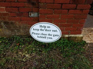 help us keep the deer out please close gate behind you sign