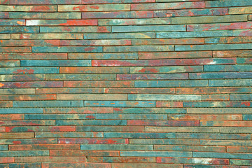 Motley multi-colored wall folded from flat bricks background texture