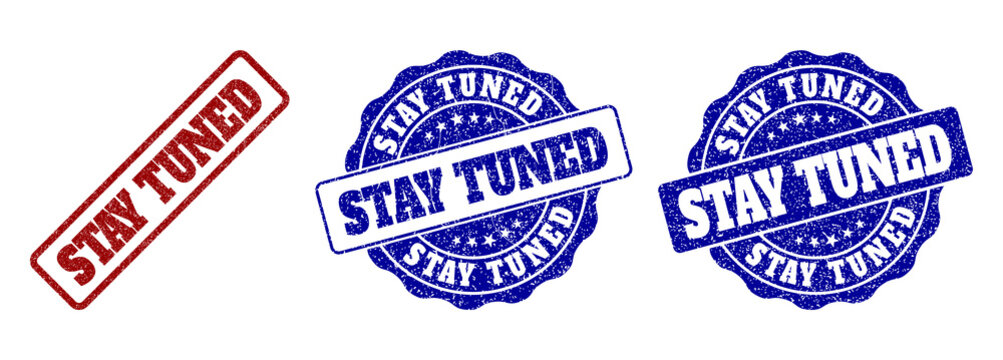 STAY TUNED scratched stamp seals in red and blue colors. Vector STAY TUNED marks with dirty texture. Graphic elements are rounded rectangles, rosettes, circles and text labels.