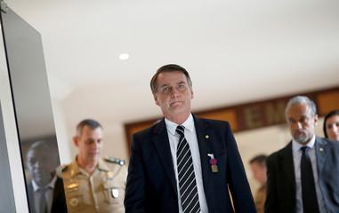 Brazil's President-elect Jair Bolsonaro walks at the Army Headquarters in Brasilia