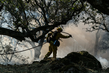 Fire crews work to battle the Nunn fire in Sonoma, California