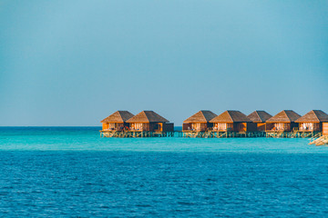 Beautiful beach with water bungalows or water villas at Maldives