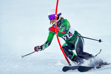 Wall Mural - An alpine skier punching a gate during a slalom race.