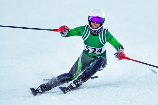 An alpine ski racer rounding a gate during a race.
