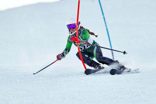 An alpine skier racing on the slalom course.