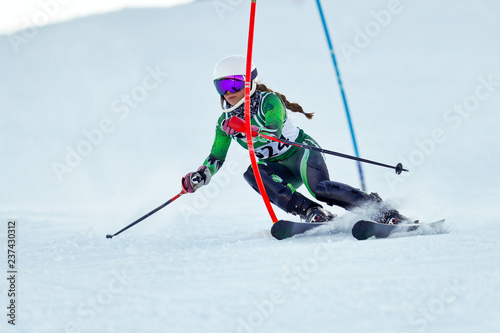 Wall mural An alpine skier racing on the slalom course.