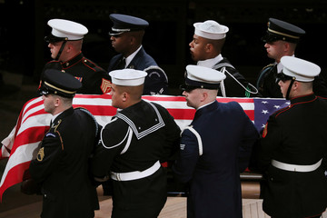 Military honor guard carries casket out of state funeral for his father former U.S. President George H.W. Bush at Washington National Cathedral