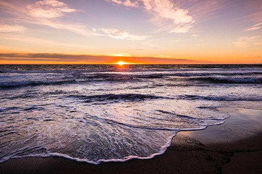 Sunset view of Malibu beach, the Pacific Ocean coastline, Los Angeles county, California