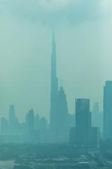 Dubai, UAE - October, 2018. Beautiful skyline of Dubai surrounded by sand dust at day light