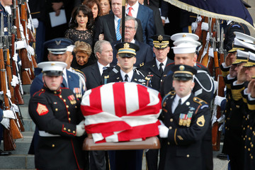Former U.S. President George W. Bush follows behind honor guard carrying casket of George H.W. Bush at Washington National Cathedral