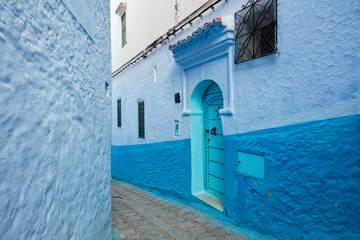 street with emerald door in blue city Chefchaouen in Morocco