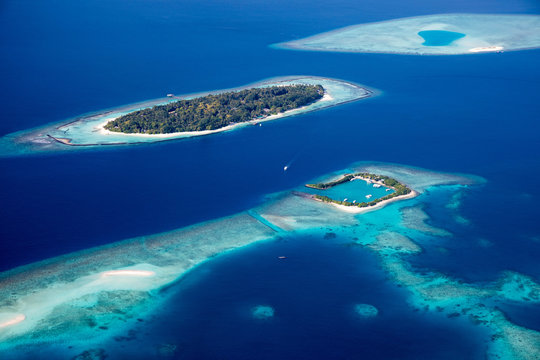 Aerial of the beautiful Maldives, looking down at some stunning islands and atolls