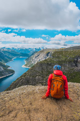 Sporty woman posing on Trolltunga Norway
