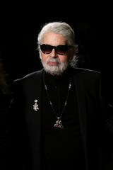 Designer Karl Lagerfeld stands on the runway after the CHANEL Paris New York Métiers d'art 2018/19 Show at Metropolitan Museum of Art in New York