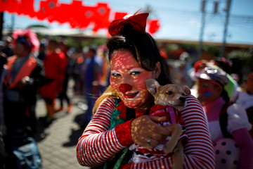 Salvadorean clown Blankyta poses for a picture during Salvadoran Clown Day celebrations in Santa Tecla
