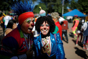 Salvadorean clowns wait to participate in a parade during Salvadoran Clown Day celebrations in Santa Tecla
