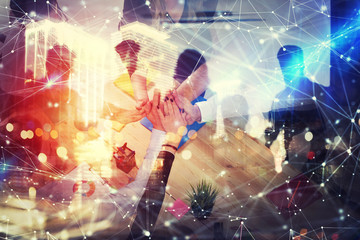 Handshaking business person in office. concept of teamwork and partnership. double exposure with network effects