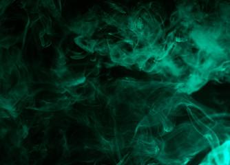 colorful aquamarine smoke isolated on black background