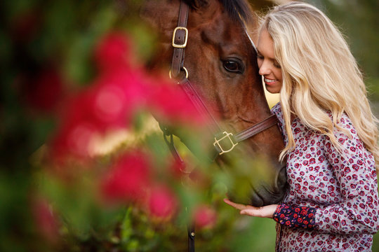 Woman Cuddling with Horse