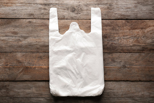Clear disposable plastic bags on wooden background