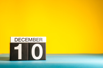 December 10th. Image 10 day of december month, calendar on yellow background with empty space for text