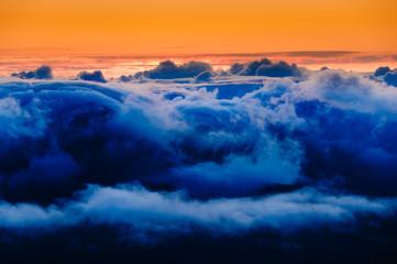 Clouds at sunrise over Haleakala Crater, Maui, Hawaii, USA
