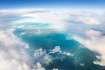 Aerial view of clouds and earth from above