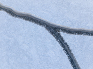Aerial view of a rift on the ice of a winter lake