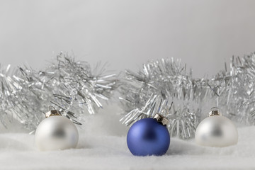 Christmas Ornaments with silver garland on gray background, horizontal