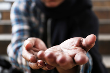 Close up hand of homeless man on walking street in the capital city.