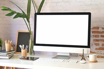 Mockup modern blank screen desktop computer on stylish workspace.