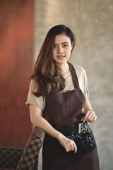 Portrait of Asian barber girl in a beauty salon.