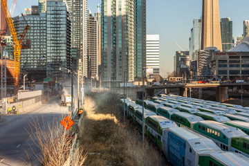 Toronto, Canada – December 4th 2018 high residential towers above the tracks with GO trains in Toronto under a blue sky