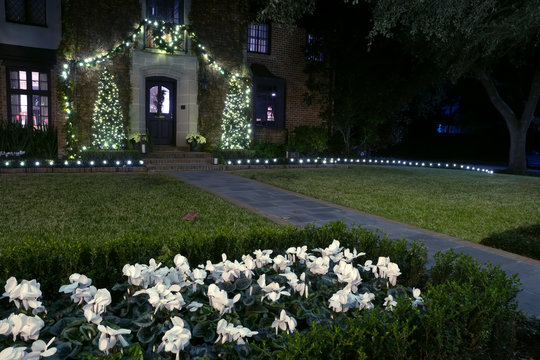 House entrance decorated for Christmas with garlands and flowers. Christmas decor. Winter, Night, Houston, Texas,  United States